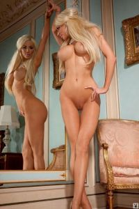 Nicolette Shea Shows Off Her Set Of Twins In The Mirror
