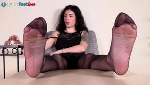 Sexy brunette in pantyhose puts her feet in your face
